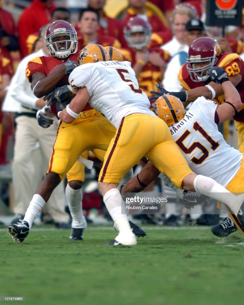 Tailback CJ Gable of the University of Southern California Trojans is tackled by the Sun Devils defense in a 28 to 21 win over the Arizona State...