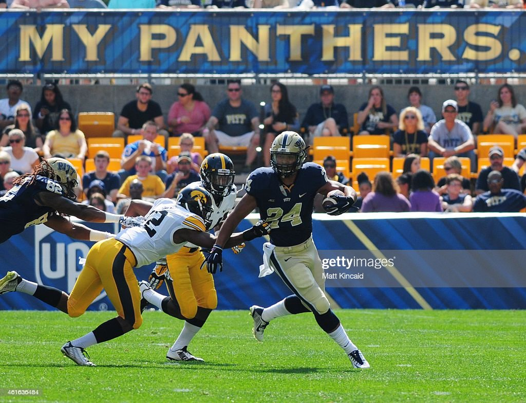 Tailback James Conner #24 of the University of Pittsburgh Panthers runs with the ball against the University of Iowa Hawkeyes during a college football game at Heinz Field on September 20, 2014 in Pittsburgh, Pennsylvania. The Hawkeyes defeated the Pitt Panthers 24-20.