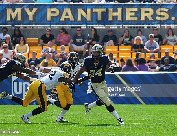 Tailback James Conner of the University of Pittsburgh Panthers runs with the ball against the University of Iowa Hawkeyes during a college football...