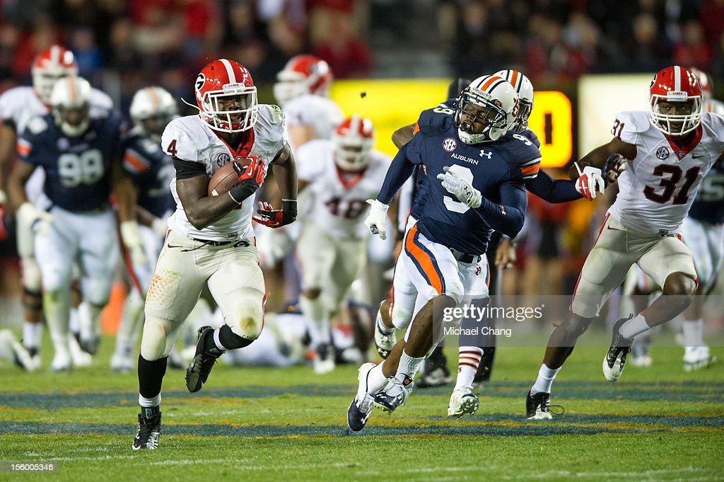 Tailback Keith Marshall #4 of the Georgia Bulldogs runs downfield while being chased by defensive back Jermaine Whitehead #9 of the Auburn Tigers on November 10, 2012 at Jordan-Hare Stadium in Auburn, Alabama. Georgia defeated Auburn 38-0 and clinched the SEC East division.