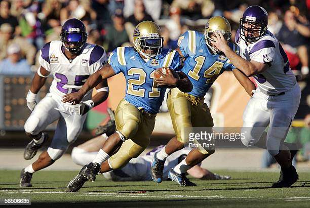 Tailback Maurice Drew of the UCLA Bruins runs against the Northwestern Wildcats in the third quarter during the Vitalis Sun Bowl on December 30 2005...
