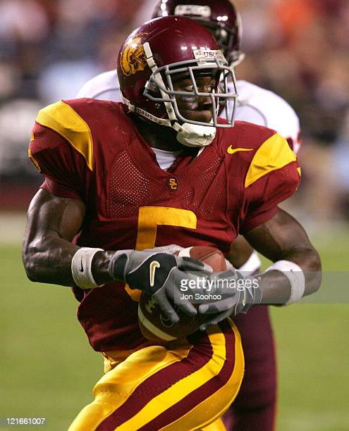 Tailback Reggie Bush of the University of Southern California catches a touchdown pass from quarterback Matt Leinart not shown in the third quarter...