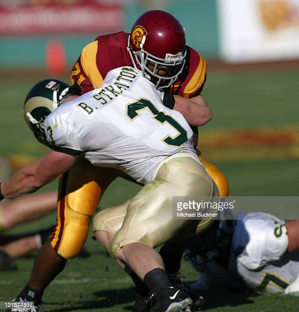 Tailback Reggie Bush of the University of Southern California runs into Ben Stratton of Colorado State University during the 490 win at the Los...