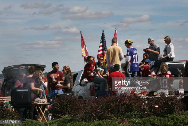 Tailgating in the stadium parking lot before the Washington Redskins play the Jacksonville Jaguars at FedEx Field on September 14 2014 in Landover MD