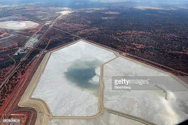 Tailings dams sit at the Fimiston Open Pit mine known as the Super Pit in this aerial photograph taken above Kalgoorlie Australia on Monday Aug 3...