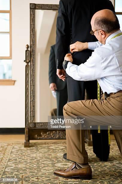 Tailor adjusts coat vent