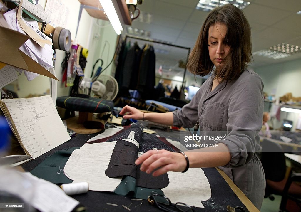 Tailor Emily Squires is pictured inside clothing shop ...