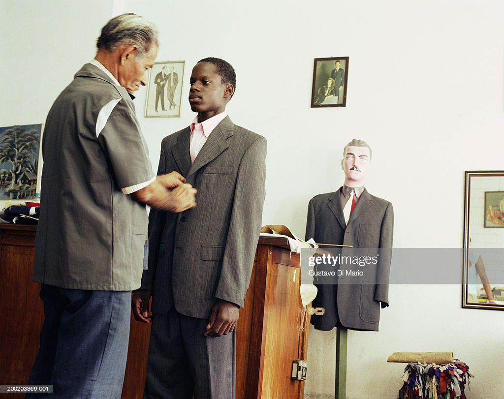Tailor fitting suit on boy (11-13) : Foto stock