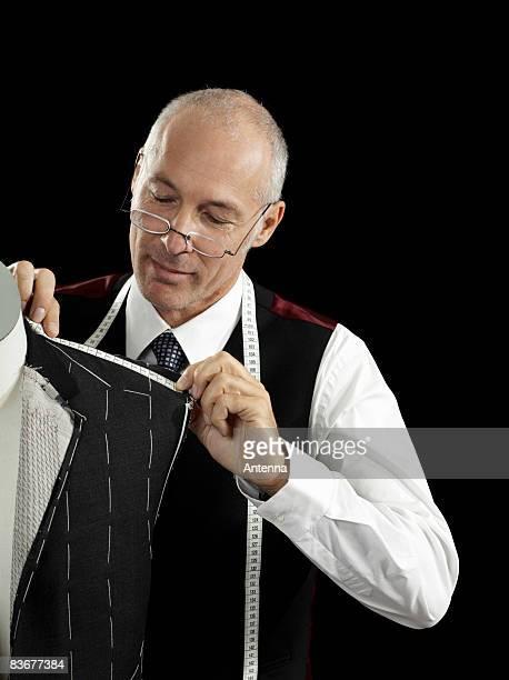 A tailor making a suit