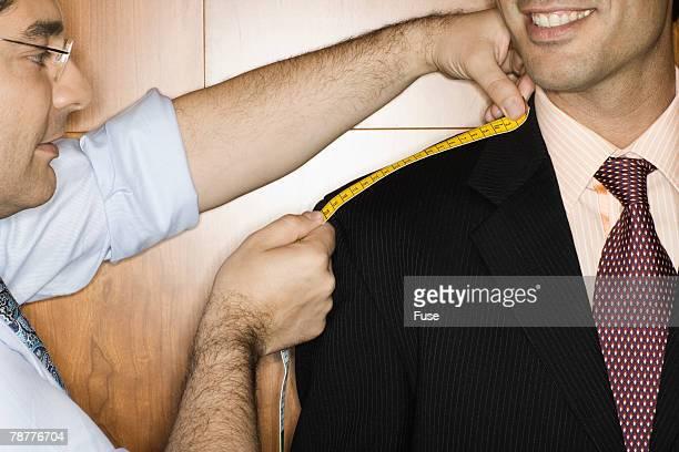 Tailor Measuring Businessman