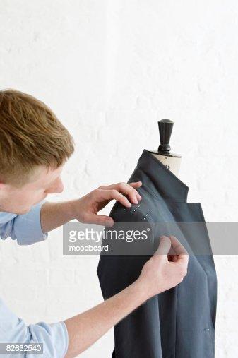 Tailor pinning sleeve to jacket