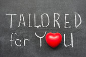 tailored for you phrase handwritten on blackboard with heart symbol instead of O