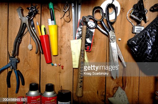 Tailor's tools hanging on wooden panel, close-up : Stock Photo