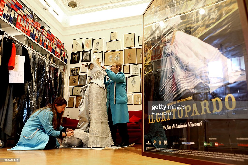 Tailors work on a dress by costume designer Gabriella Pescucci for the TV Series 'Penny Dreadful' at the Tirelli Atelier on February 20, 2015 in Rome, Italy. The costumier Tirelli was established in 1964 and is responsible for the creation of costumes for films and well-known productions, including almost all of Luchino Visconti's films (designed by Piero Tosi). Tirelli has created costumes for a great many films for which it has won Academy Awards as well as other awards for Best Costume (Amadeus, Casanova, Cyrano, The English Patient, Age of Innocence, Marie Antoinette etc.).