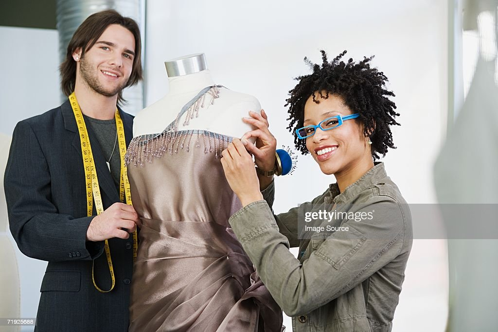 Tailors working on dress : Stock Photo