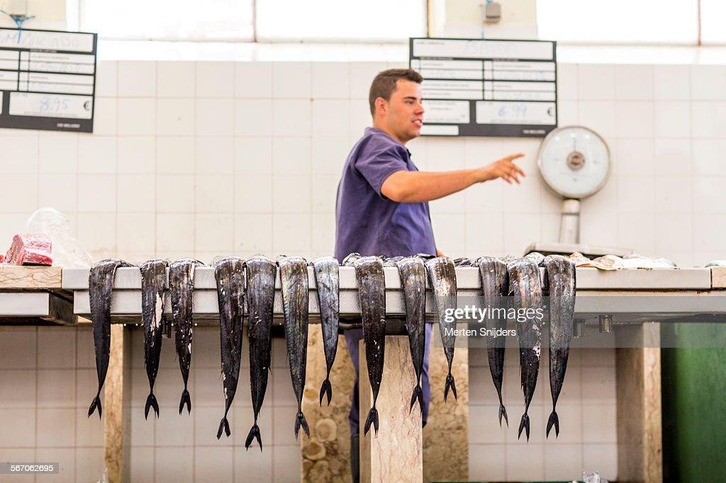 Tails of long fish at Fishmonger stall