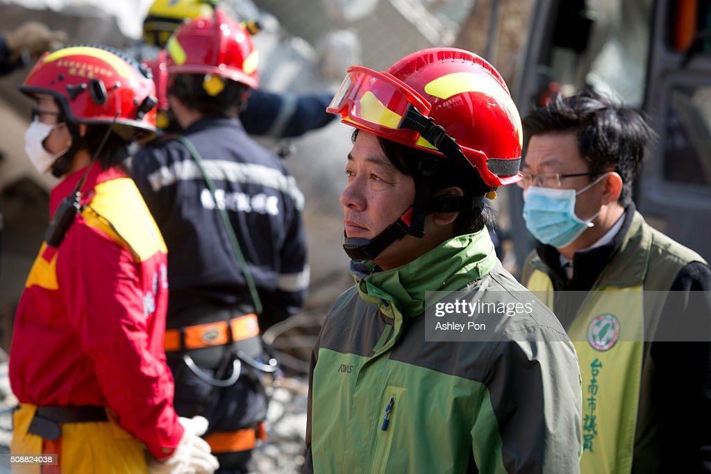Tainan city mayor Lai, Ching-Te at the site of collapsed buildings on February 7, 2016 in Tainan, Taiwan. A magnitude 6.4 earthquake hit southern Taiwan early Saturday, toppling several buildings, killing at least fourteen people, and leaving over one hundred missing in Tainan.