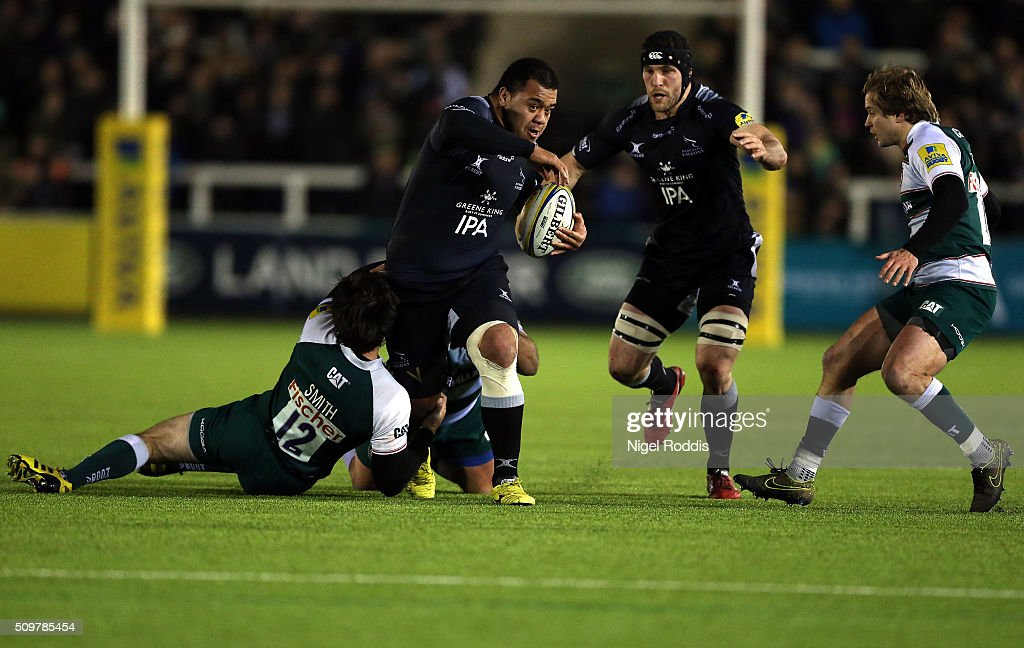 Taione Vea (2ndL) of Newcastle Falcons breaks the tackle of <a gi-track='captionPersonalityLinkClicked' href=/galleries/search?phrase=Matt+Smith+-+Rugby+Player&family=editorial&specificpeople=6877374 ng-click='$event.stopPropagation()'>Matt Smith</a> (L) of Leicester Tigers during the Aviva Premiership match between Newcastle Falcons and Leicester Tigers at Kingston Park on February 12, 2016 in Newcastle upon Tyne, England.