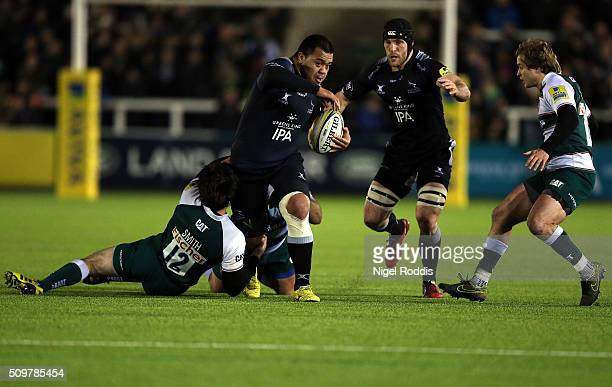 Taione Vea of Newcastle Falcons breaks the tackle of Matt Smith of Leicester Tigers during the Aviva Premiership match between Newcastle Falcons and...