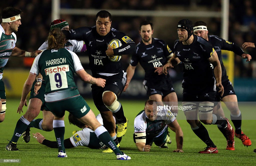 Taione Vea (C) of Newcastle Falcons runs at Sam Harrison (2ndL) of Leicester Tigers during the Aviva Premiership match between Newcastle Falcons and Leicester Tigers at Kingston Park on February 12, 2016 in Newcastle upon Tyne, England.