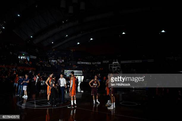 Taipans and Bullets players stand on the court during a black out due to power failure in the final quarter of the round six NBL match between the...