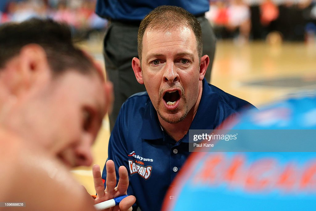 Taipans coach Aaron Fearne addresses his players in a time out during the round 15 NBL match between the Perth Wildcats and the Cairns Taipans at Perth Arena on January 18, 2013 in Perth, Australia.