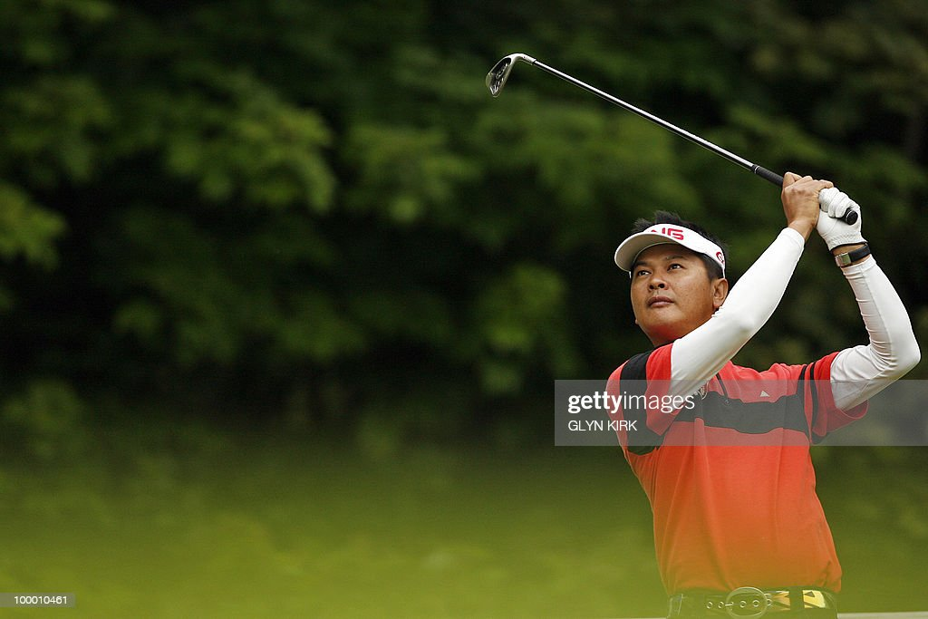 Taipei golfer Wen-Tang Lin watches his drive from the 2nd tee on the first day of the PGA Championship on the West Course at Wentworth, central England on May 20, 2010.