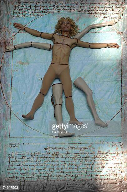 A man plays as the Vitruvian Man during the exhibition of the Renaissance Man Leonardo Da Vinci's Scientific Code at the National Taiwan Science...