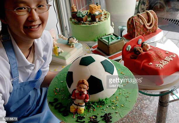 CORRECTION TO GO WITH STORY 'AFPLifestyleTaiwangastronomyoffbeat' Cake maker Lin Yuan poses with cakes of novelty designs in her shop in Taipei 07...