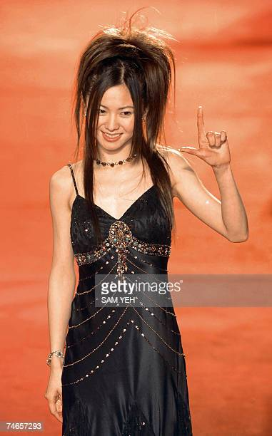 Japanese singer Mai Kuraki poses on the red carpet as she arrives for the 18th Golden Melody Awards in Taipei 16 June 2007 Pop singers from Taiwan...