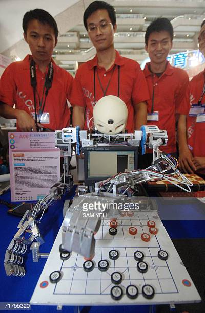 University students display their robot designed to play chess during the 2006 Taipei Intenational Invention Show and Technomart 31 August 2006...