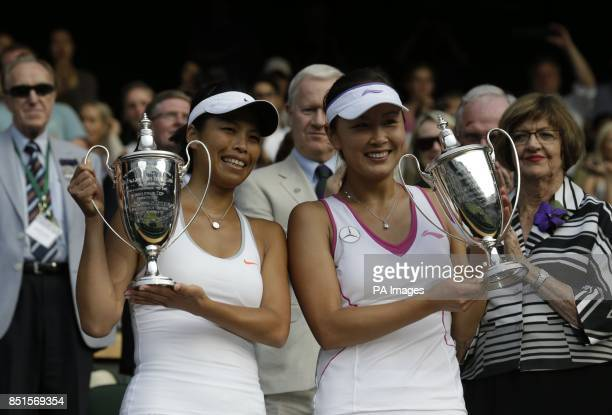 Taipei's SuWei Hsieh and China's Shuai Peng celebrate with their trophies after winning their Ladies' Doubles Final against Australia's Ashleigh...