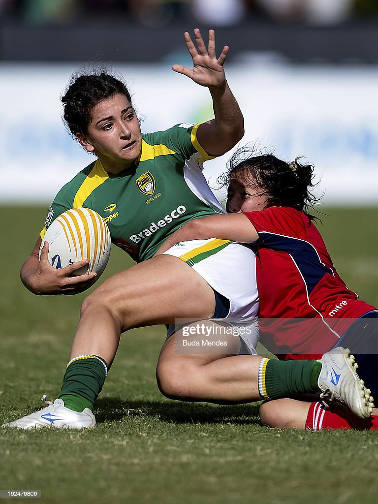 Tais Balconi of Brazil (green jersey) fights for the ball with a player of Chile during a rugby match as part of the Rio Sevens 2013 - South American Championship at the Gavea Stadium on February 23, 2013 in Rio de Janeiro, Brazil.