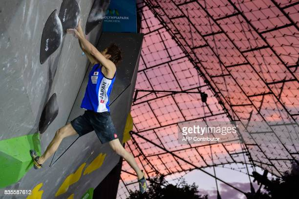 Taisei Ishimatsu of Japan competes during the men's event of the IFSC Bouldering Worldcup in the southern German city of Munich on August 19 2017 /...