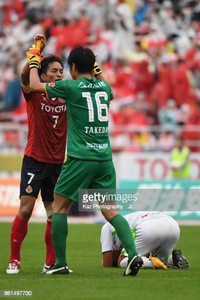 Taishi Taguchi and Yohei Takeda of Nagoya Grampus celebrate their 32 victory in the JLeague J2 match between Nagoya Grampus and Shonan Bellmare at...