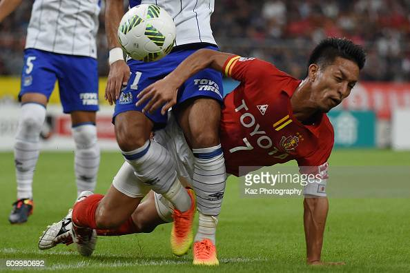 Taishi Taguchi of Nagoya Grampus charged by Yosuke Ideguchi of Gamba Osaka during the J League match between Nagoya Grampus and Gamba Osaka at the...