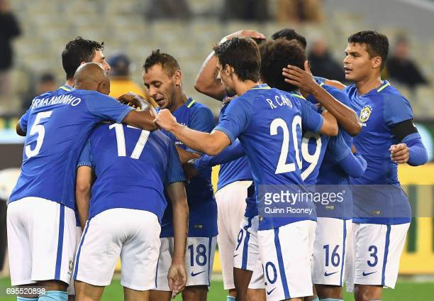 Taison Freda of Brazil is congratulated by team mates after kicking a goal during the Brazil Global Tour match between Australian Socceroos and...