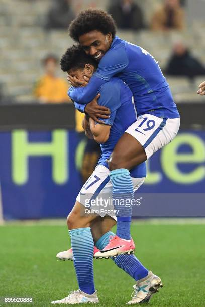 Taison Freda of Brazil is congratulated by Willian Silva after kicking a goal during the Brasil Global Tour match between Australian Socceroos and...