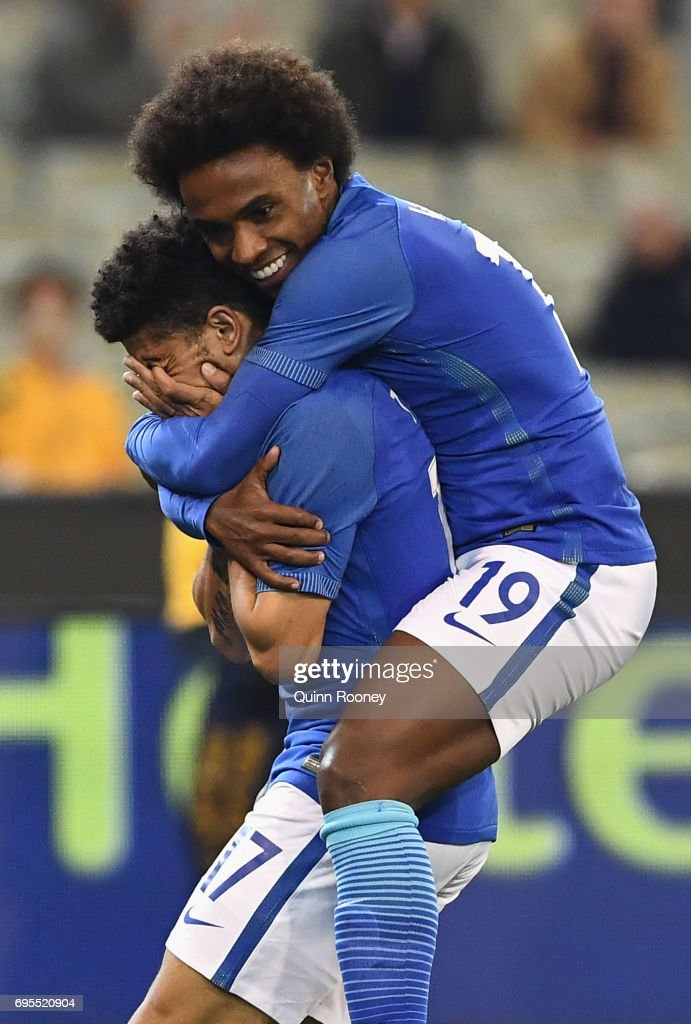 Taison Freda of Brazil is congratulated by Willian Silva after kicking a goal during the Brasil Global Tour match between Australian Socceroos and Brazil at Melbourne Cricket Ground on June 13, 2017 in Melbourne, Australia.