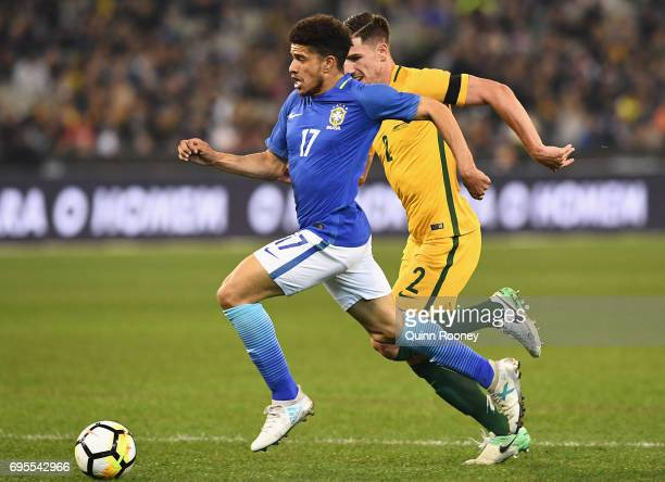Taison Freda of Brazil looks to pass the ball during the Brasil Global Tour match between Australian Socceroos and Brazil at Melbourne Cricket Ground...