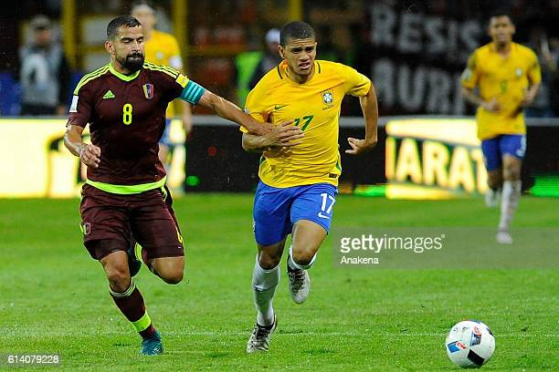 Taison of Brazil fights for the ball with Tomas Rincon of Venezuela during a match between Venezuela and Brazil as part of FIFA 2018 World Cup...
