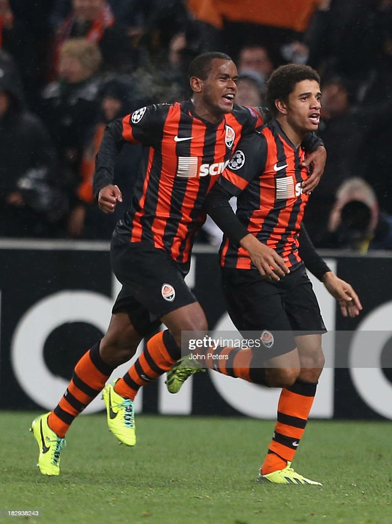 <a gi-track='captionPersonalityLinkClicked' href=/galleries/search?phrase=Taison&family=editorial&specificpeople=5613080 ng-click='$event.stopPropagation()'>Taison</a> (R) of Shakhtar Donetsk celebrates scoring their first goal during the UEFA Champions League Group A match between Shakhtar Donetsk and Manchester United at Donbass Arena on October 2, 2013 in Donetsk, Ukraine.