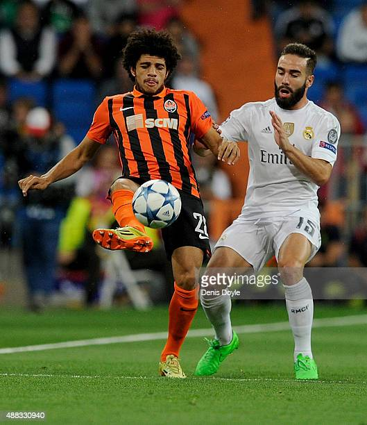 Taison of Shakhtar Donetsk is tackled by Dani Carvaja of Real Madrid during the UEFA Champions League Group A match between Real Madrid and Shakhtar...
