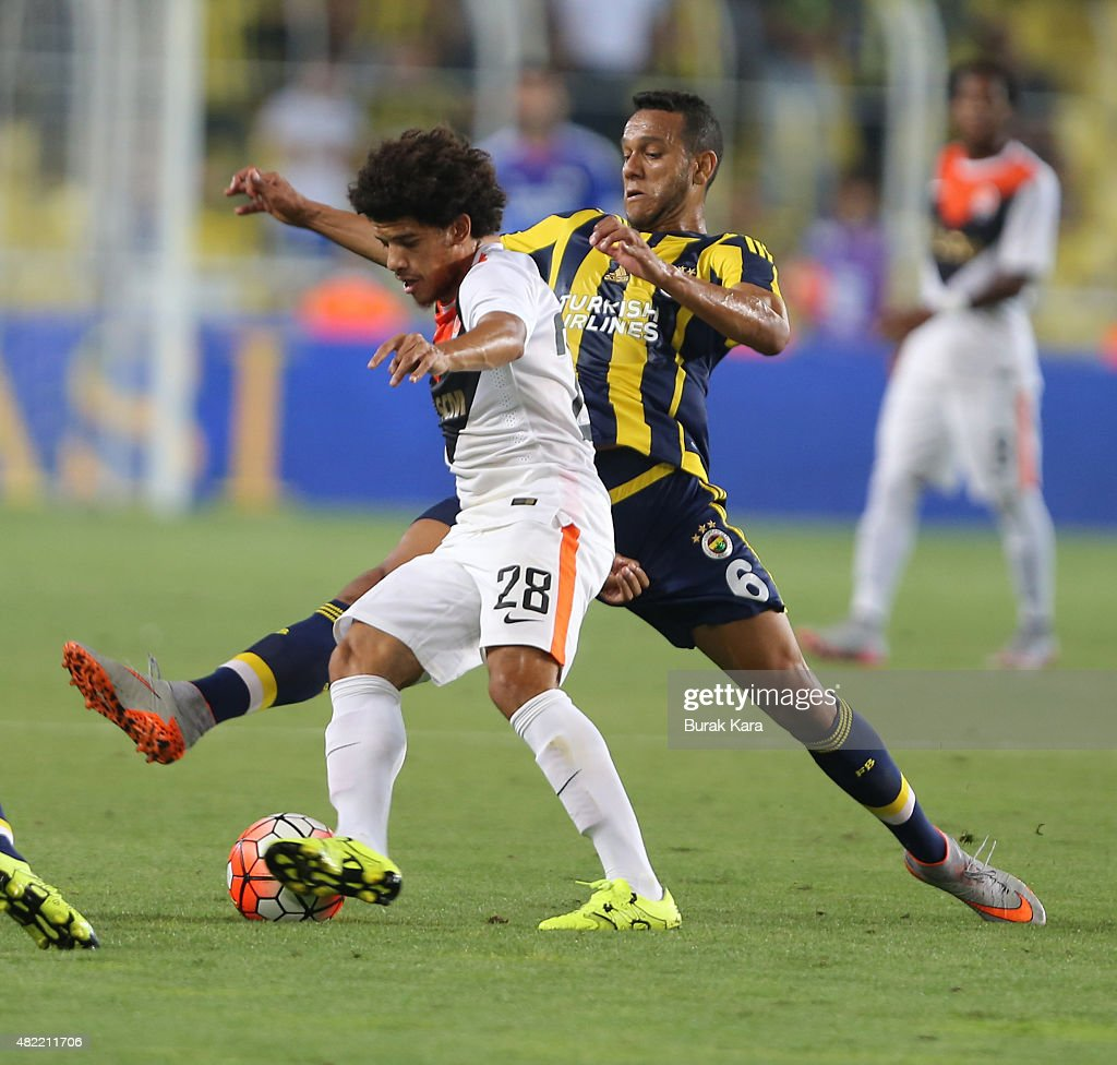 <a gi-track='captionPersonalityLinkClicked' href=/galleries/search?phrase=Taison&family=editorial&specificpeople=5613080 ng-click='$event.stopPropagation()'>Taison</a> of Shaktar Donetsk rides the ball past Souza of Fenerbahce during UEFA Champions League Third Qualifying Round 1st Leg match betweeen Fenerbahce v Shakhtar Donetsk at Sukru Saracoglu Stadium on July 28, 2015 in Istanbul, Turkey.