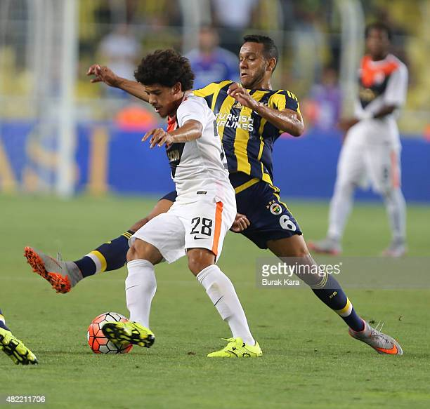 Taison of Shaktar Donetsk rides the ball past Souza of Fenerbahce during UEFA Champions League Third Qualifying Round 1st Leg match betweeen...