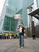 TAIPEI Taiwan A man holds a sign saying ''occupy Taipei'' in front of the Taipei 101 tower in Taipei on Oct 15 2011 Movements inspired by the Occupy...