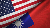 Taiwan and United States flags together textile cloth, fabric texture