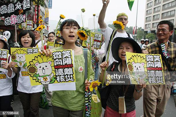 TAIPEI Taiwan Ayako Oga and Saeko Uno from Fukushima Prefecture in northeastern Japan take part in a protest against nuclear power in Taipei on April...