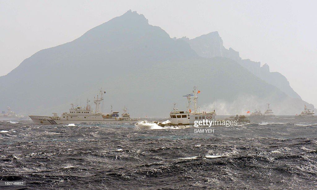 A Taiwan Coast Guard boat is blocked by a Japan Coast Guard vessel in the waters near the disputed Diaoyu / Senkaku islands in the East China Sea on...