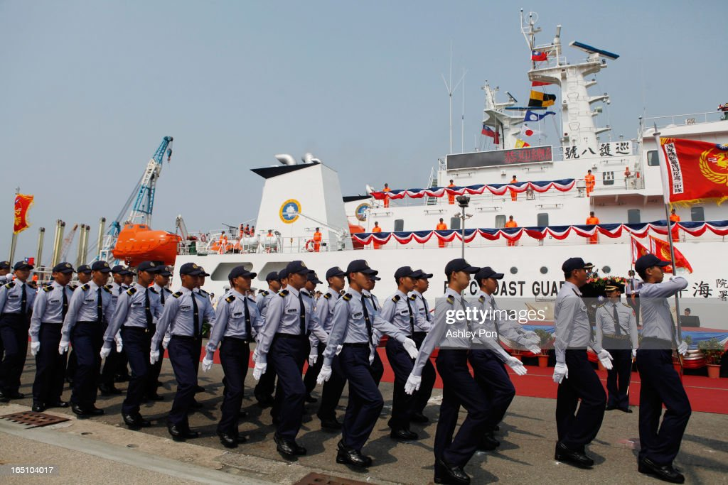 Taiwan Coast Guards passing through the Fishery Petrol Ship no. 8 at its commissioning ceremony on March 30, 2013 in Kaohsiung, Taiwan. President Ma Ying-jeou has unveiled two new ships that will patrol the waters off the disputed islands in the East China Sea at the centre of a current regional territorial row.